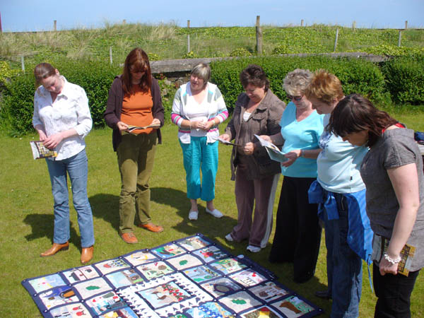 Women engrossed in a quilt at the workshop in Downhill Hostel, County Derry, 31st May 2007, in preparation for the 2008 exhibition:
