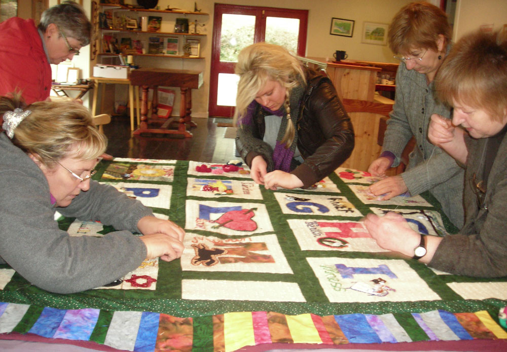 Women engrossed in finishing off the Alphabet Quilt.  (Photo: Deborah Stockdale)