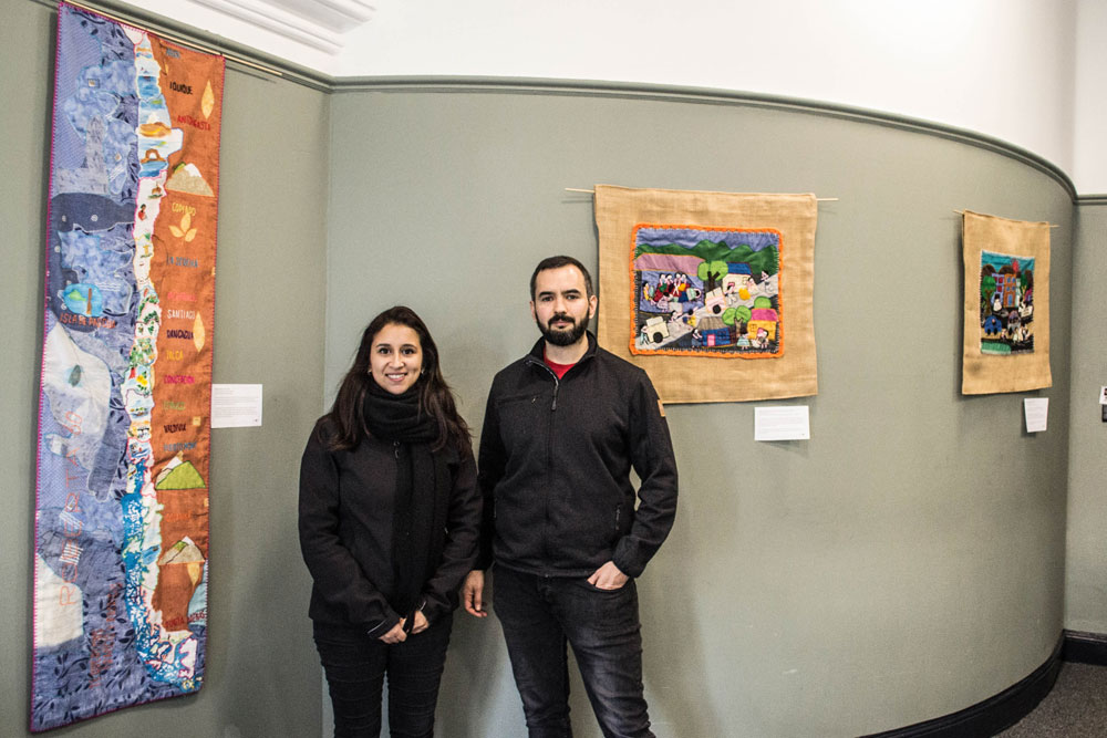 Serguey Maximov, President Edinburgh Chilean Society and Rosa Santibáñez pictured at the exhibition of arpilleras as part of the