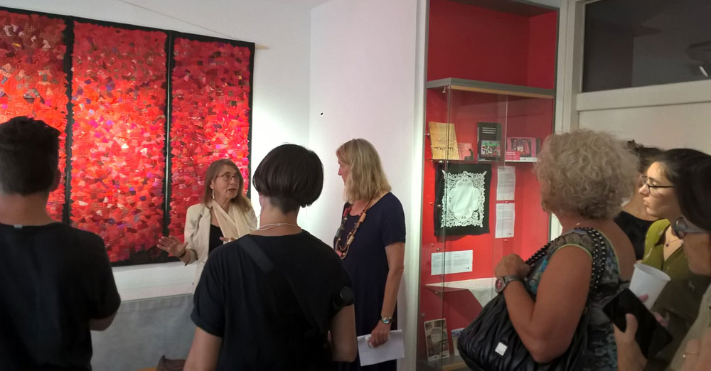 Curator Roberta Bacic with (to her right) Vesna Teršelič, director of Documenta - Centre for Dealing with the Past, during a guided tour at the exhibition launch, 14th September 2019. (Photo: Tajana Ban Kirigin)