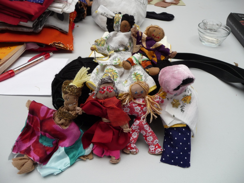 Arpillera dolls made during the workshop by participants. (Photo: Shelley Anderson)