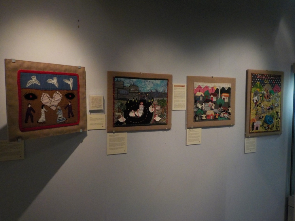 Arpilleras on display at the Tower Museum (June - December 2016). These four pieces were previously shown in the Victoria and Albert Museum, London, as part of