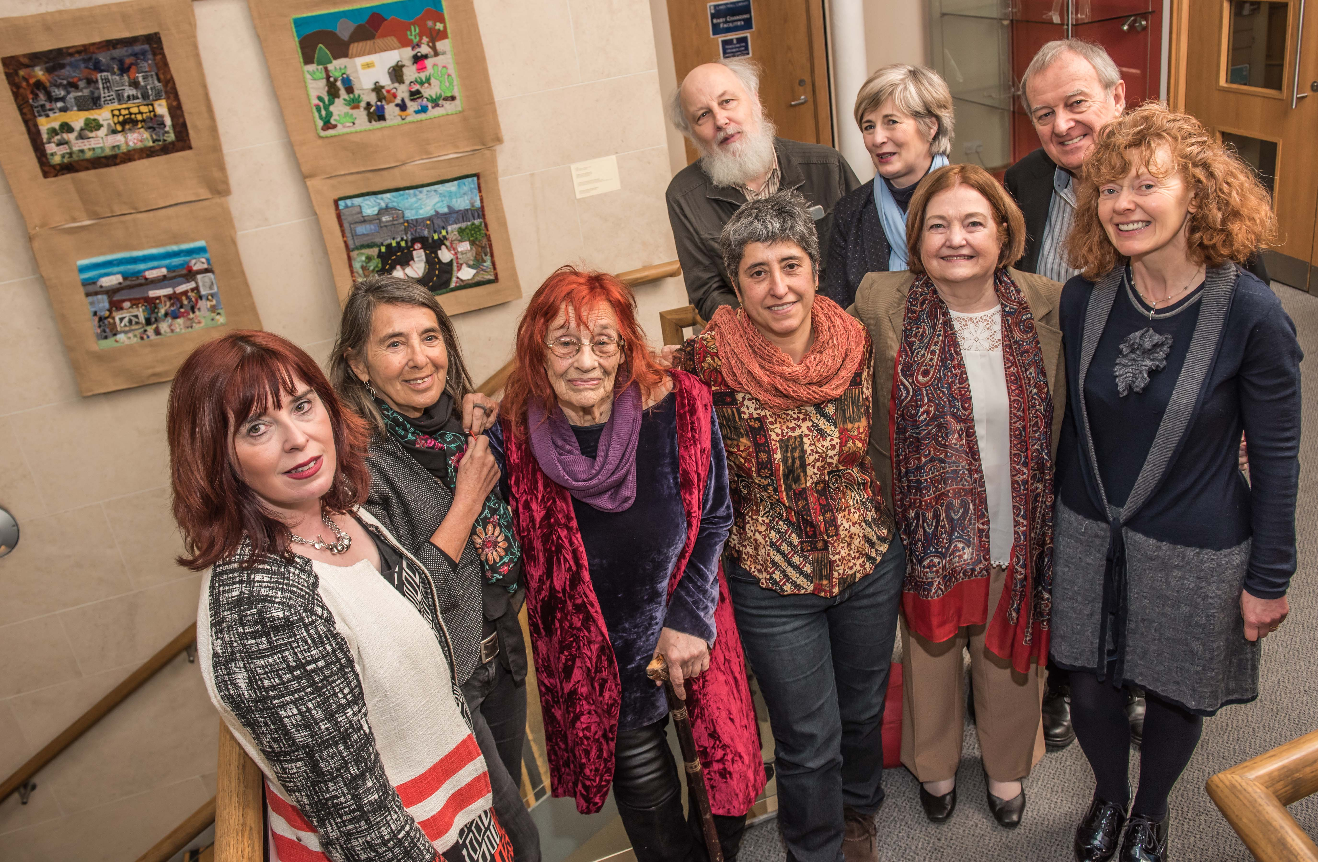 The exhibition team with Margaretta D'Arcy, Peace Activist (3rd from left); Maired Maguire, Nobel Peace Laureate (2nd from right); and Phil Scraton, Emeritus Professor of Criminology, QUB (back row, right), at the launch. (Photo: Linenhall Library)